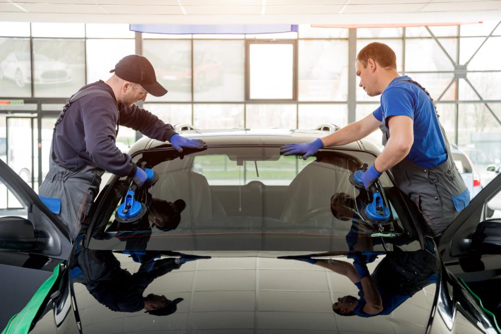 Delaware Auto Glass technicians replacing broken windshield.